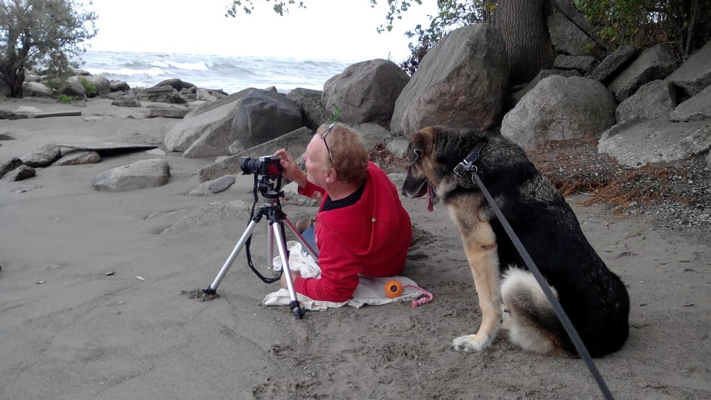 Ian and goofy taking a photograph at the beach