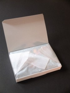 Box opened - revealing tissue paper